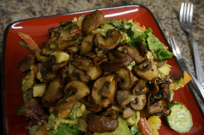 Giant salad covered in mushrooms