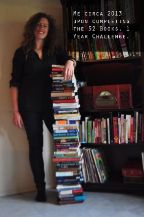 Me standing next to the stack of books I read in one year.